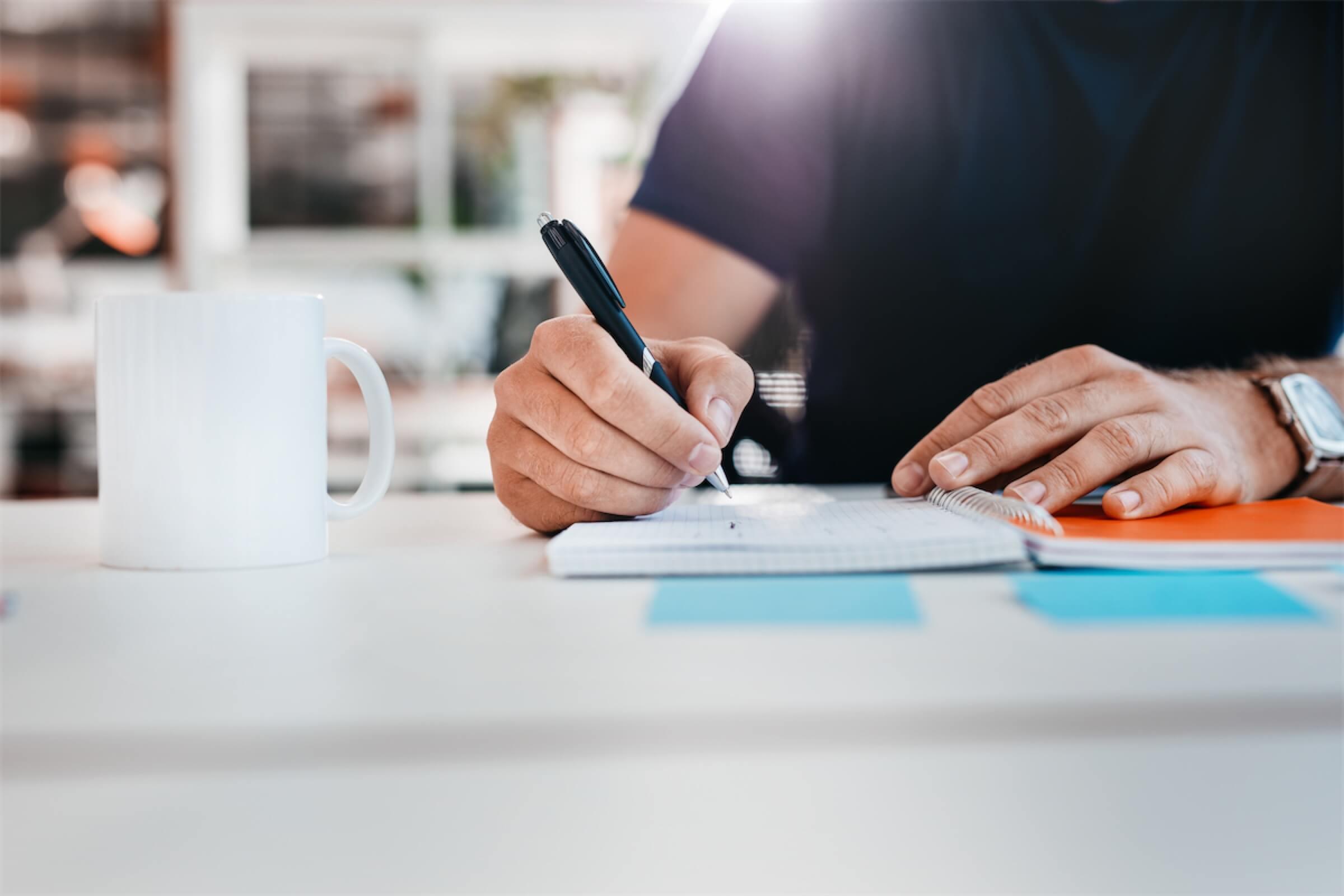 Closeup of hands writing notes