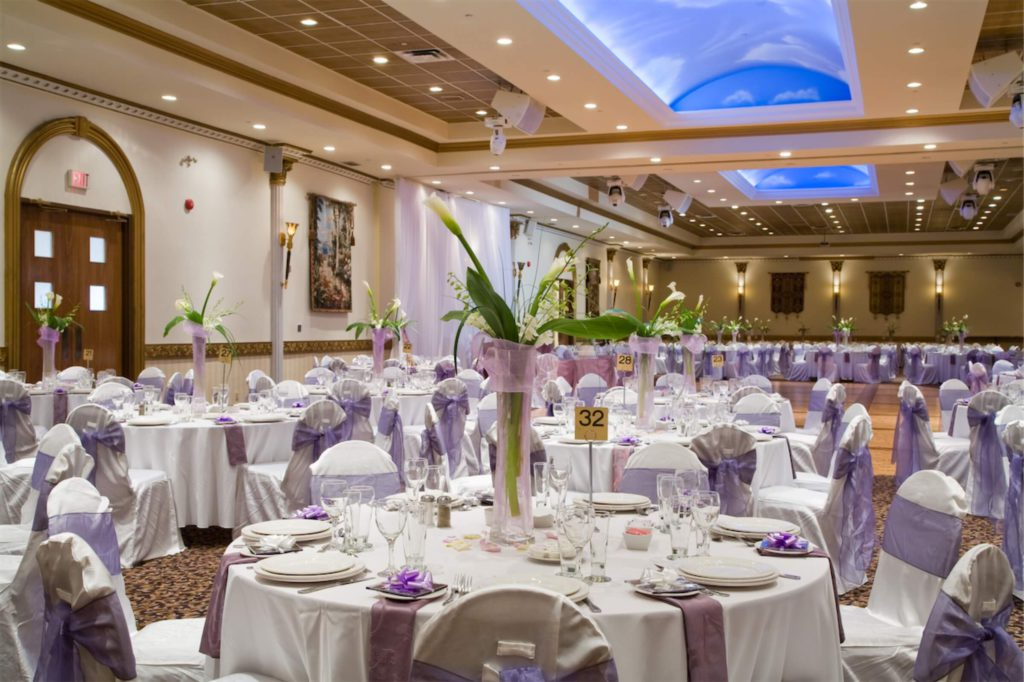 A hotel ballroom with a wedding banquet setting, which can be funded by a personal loan in Singapore