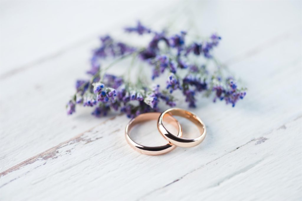 A pair of gold wedding bands on a table