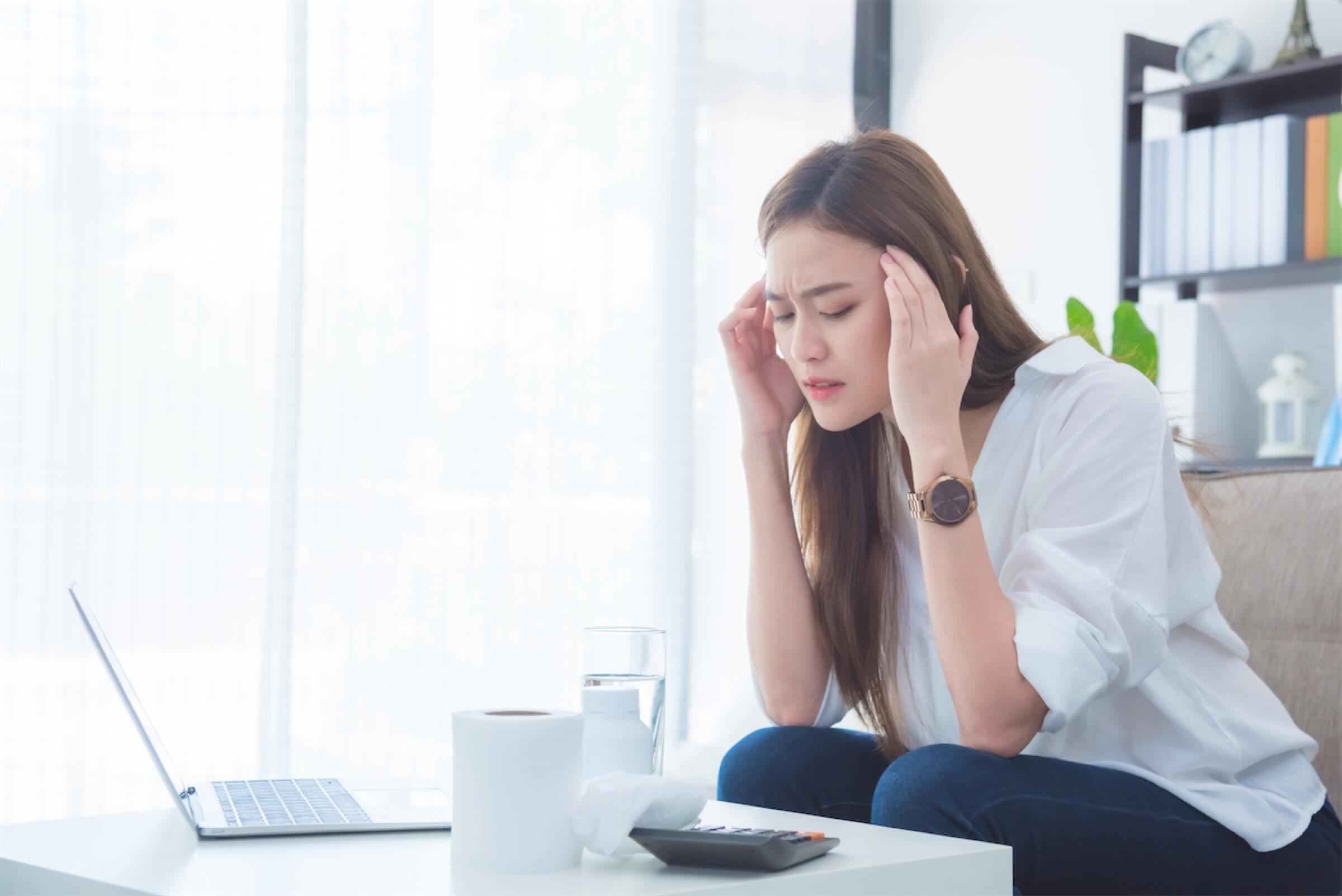 A woman stressed over her finances