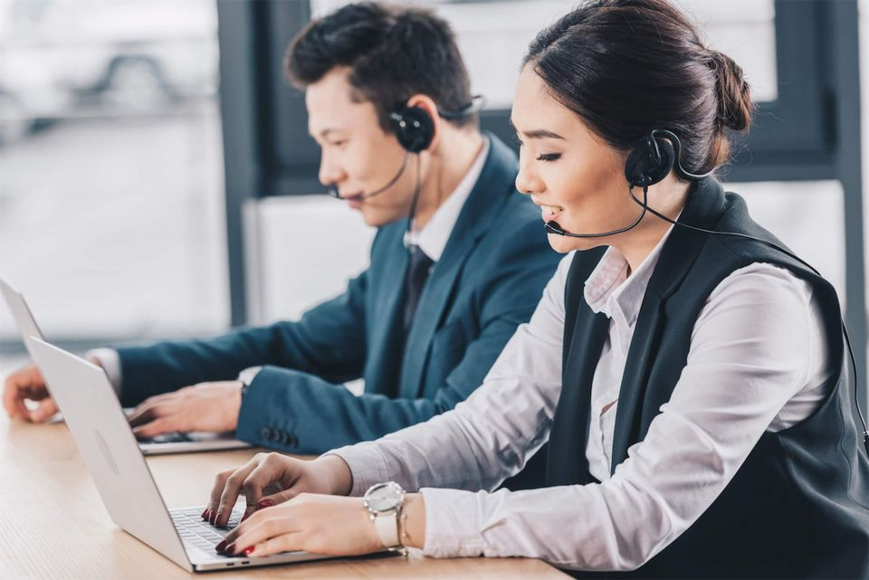 Call center customer service working in the office